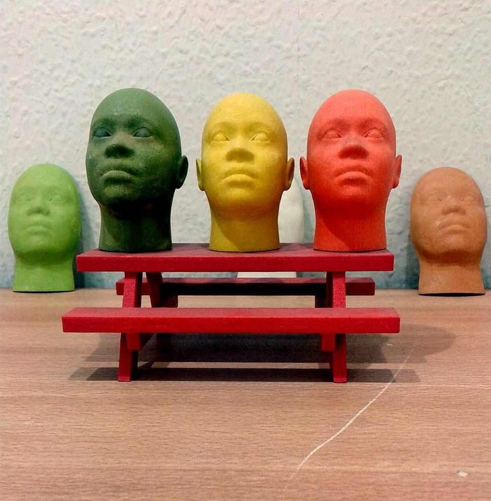 Full colour miniature face models produced on a 3D Printer. Photo: Creative Commons/S zillayali
